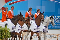 Team of the Netherlans winners of the FEI Nations Cup Rome 2011<br /> Van der Vleuten Eric, Smolders Harry, Dubbeldam Jeroen, Schroder Gerco<br /> © Dirk Caremans