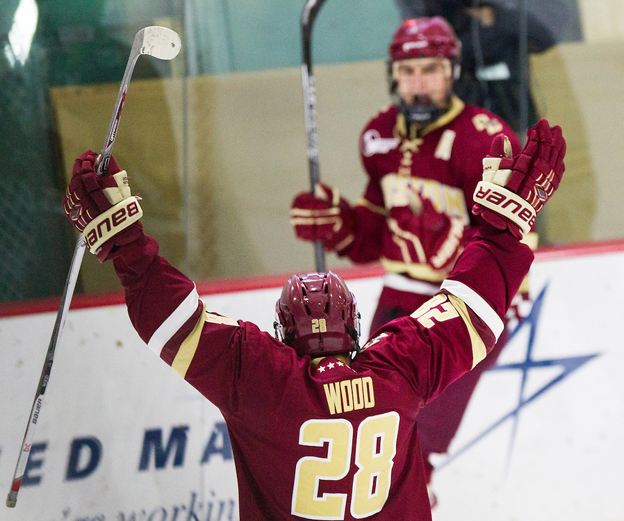 Boston College Forward Miles Wood (28) celebrates Boston College Forward Chris Calnan's (11) goal during the second period of a NCAA hockey game between Army and Boston College at Tate Rink on October 9, 2015 in West Point, New York. (Dustin Satloff)