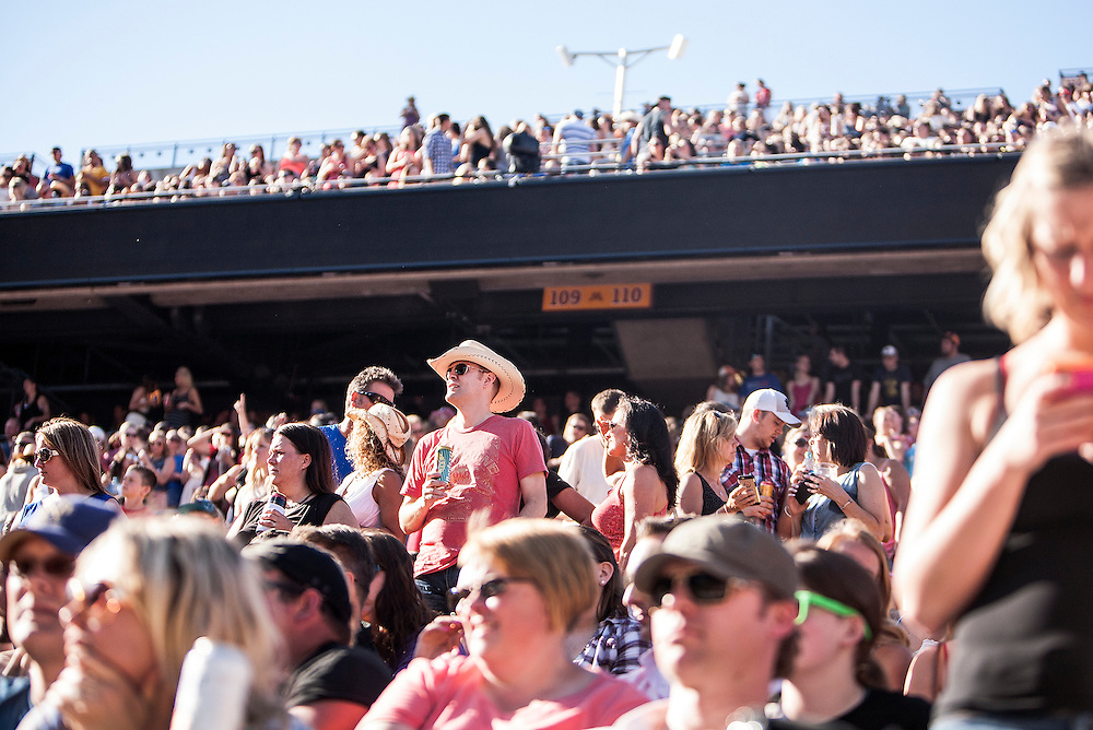 Fans fill the stadium at the Luke Bryan Kick The Dust Up Tour at TCF Bank Stadium in Minneapolis June 20, 2015.