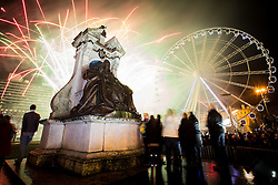 © Licensed to London News Pictures . 01/01/2014 . Manchester , UK . Celebrations and fireworks in Manchester's Piccadilly Gardens overnight (31st December 2013/1st January 2014) to mark the start of the New Year ( 2014 )  . Photo credit : Joel Goodman/LNP