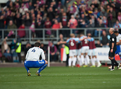 Sean Morrison of Cardiff City looks dejected as Chris Wood of Burnley celebrates scoring his sides second goal - Mandatory by-line: Jack Phillips/JMP - 13/04/2019 - FOOTBALL - Turf Moor - Burnley, England - Burnley v Cardiff City - English Premier League