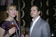 Karoline Copping and Jimmy Carr, Dom Perignon and Exit present Room service, an exhibition of photographs featuring Eva Herzigova  by Karl Largerfeld. -DO NOT ARCHIVE-© Copyright Photograph by Dafydd Jones 66 Stockwell Park Rd. London SW9 0DA Tel 020 7733 0108 www.dafjones.com