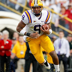 November 25, 2011; Baton Rouge, LA, USA; LSU Tigers quarterback Jordan Jefferson (9) runs for a touchdown against the Arkansas Razorbacks during the fourth quarter of a game at Tiger Stadium. LSU defeated Arkansas 41-17. Mandatory Credit: Derick E. Hingle-US PRESSWIRE