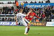 Stephen Kingsley of Swansea City and Marouane Fellaini of Manchester United during the Premier League match between Swansea City and Manchester United at the Liberty Stadium, Swansea, Wales on 6 November 2016. Photo by Andrew Lewis.