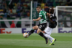 September 20, 2018 - Lisbon, Portugal - Sporting's defender Stefan Ristovsk from Macedonia (L) vies with Qarabag's forward Innocent Emeghara during the UEFA Europa League Group E football match Sporting CP vs Qarabag at Alvalade stadium in Lisbon, on September 20, 2018. (Credit Image: © Pedro Fiuza/NurPhoto/ZUMA Press)