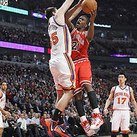 12 March 2012: Chicago Bulls guard Jimmy Butler (21) goes to the basket against New York Knicks forward Josh Harrellson (55) during the first half of New York Knicks vs Chicago Bulls, at the United Center, Chicago, Illinois, USA.