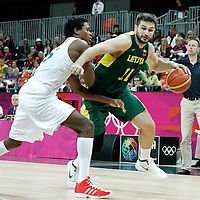 02 August 2012: Lithuania Linas Kleiza drives past Mickael Gelabale during 82-74 Team France victory over Team Lithuania, during the men's basketball preliminary, at the Basketball Arena, in London, Great Britain.