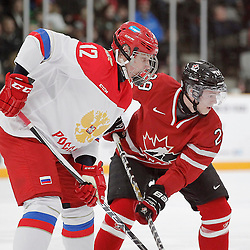 TRENTON, - Dec 10, 2015 -  Exhibition Game 3-  Russia vs Team Canada West at the 2015 World Junior A Challenge at the Duncan Memorial Gardens, ON. Artem Ivanyuzhenkov #12 of Team Russia and Kyle Betts #29 of Team Canada West during the face-off (Photo: Amy Deroche / OJHL Images)