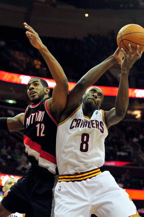 Feb. 5, 2011; Cleveland, OH, USA; Portland Trail Blazers power forward LaMarcus Aldridge (12) and Cleveland Cavaliers guard Christian Eyenga (8) fight for a rebound during the first quarter at Quicken Loans Arena. Mandatory Credit: Jason Miller-US PRESSWIRE