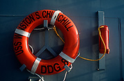A detail of a ship's lifebuoy on board the US Navy's USS Winston Churchill during its visit to the UK, on 23rd August 2001, in Portsmouth, England. The USS Winston Churchill designated DDG-81, is one of the Navy's stealth warships that was on exercise in British waters in 2001. The Churchill is an Arleigh Burke-class guided missile destroyer of the United States Navy. She is the 31st destroyer of a planned 62-ship class. The Churchill is named after the British Prime Minister Sir Winston Churchill and her home port is NS Norfolk, Virginia. (Photo by Richard Baker / In Pictures via Getty Images)