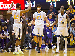 Feb 11, 2017; Morgantown, WV, USA; West Virginia Mountaineers forward Esa Ahmad (23) and West Virginia Mountaineers guard Tarik Phillip (12) and West Virginia Mountaineers guard Teyvon Myers (0) walk towards the bench during the first half against the Kansas State Wildcats at WVU Coliseum. Mandatory Credit: Ben Queen-USA TODAY Sports