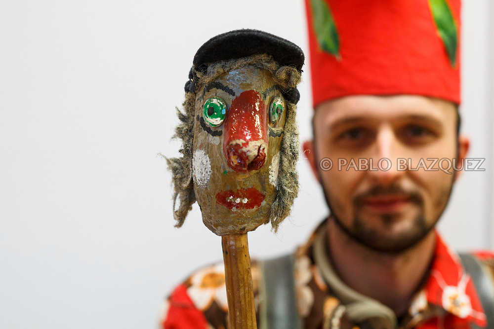 2018/02/02. ALMONACID DEL MARQUESADO, SPAIN - JANUARY 16: Worshipper Ernesto Sanchez dressed as Diablo 'Devil' poses with his porra 'baton' during the Endiablada 'The Brotherhood of the Devils' festival on February 2, 2018 in Almonacid del Marquesado, Cuenca province, Spain. La Endiablada is a centenary tradition of unknown origins celebrated on Virgen de la Candelaria 'Our Lady of Candelaria' and San Blas 'Saint Blaise' days. The Diablos wear colourful clothes, a hat and carry bells and personalised porras 'batons'. (Photo by Pablo Blazquez Dominguez)