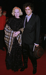 Fashion designer VIVIENNNE WESTWOOD  and her husband ANDREAS at an exhibition in London on 1st October 1997.MBU 45
