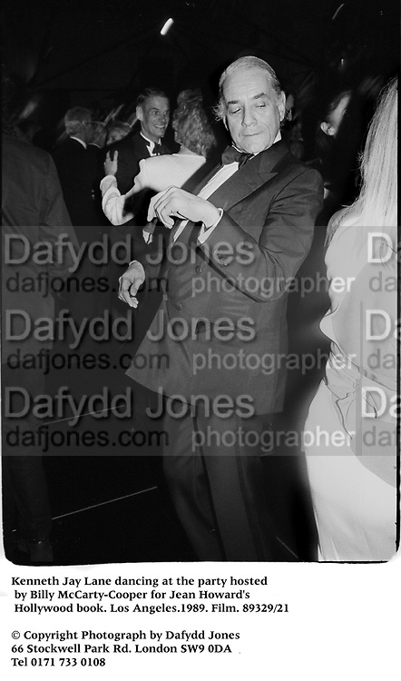 Kenneth Jay Lane dancing at a party hosted by Billy McCarty-Cooper for Jean Howard's Hollywood book. Los Angeles. 1989. Film.89329/21<br /><br />© Copyright Photograph by Dafydd Jones<br />66 Stockwell Park Rd. London SW9 0DA<br />Tel 0171 733 0108