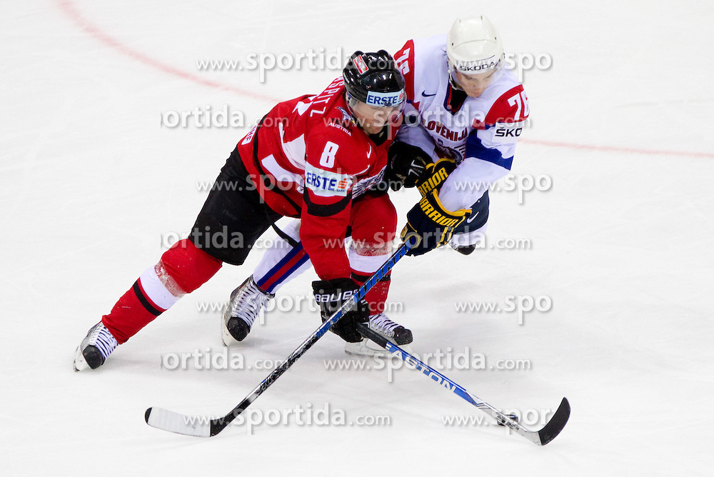 Roland Kaspitz of Austria vs Rok Pajic of Slovenia during ice-hockey match between Austria and Slovenia of Group G in Relegation Round of IIHF 2011 World Championship Slovakia, on May 7, 2011 in Orange Arena, Bratislava, Slovakia. Austria defeated Slovenia 3-2. (Photo By Vid Ponikvar / Sportida.com)