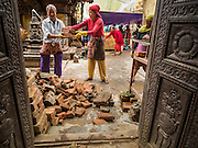 31 JULY 2015 - KATHMANDU, NEPAL: Workers recover bricks from Swayambhunath, also known as the Monkey Temple. It's a complex of Buddhist and Hindu temples in Kathmandu. It was heavily damaged in the Nepal Earthquake. The Nepal Earthquake on April 25, 2015, (also known as the Gorkha earthquake) killed more than 9,000 people and injured more than 23,000. It had a magnitude of 7.8. The epicenter was east of the district of Lamjung, and its hypocenter was at a depth of approximately 15 km (9.3 mi). It was the worst natural disaster to strike Nepal since the 1934 Nepal–Bihar earthquake. The earthquake triggered an avalanche on Mount Everest, killing at least 19. The earthquake also set off an avalanche in the Langtang valley, where 250 people were reported missing. Hundreds of thousands of people were made homeless with entire villages flattened across many districts of the country. Centuries-old buildings were destroyed at UNESCO World Heritage sites in the Kathmandu Valley, including some at the Kathmandu Durbar Square, the Patan Durbar Squar, the Bhaktapur Durbar Square, the Changu Narayan Temple and the Swayambhunath Stupa. Geophysicists and other experts had warned for decades that Nepal was vulnerable to a deadly earthquake, particularly because of its geology, urbanization, and architecture.        PHOTO BY JACK KURTZ