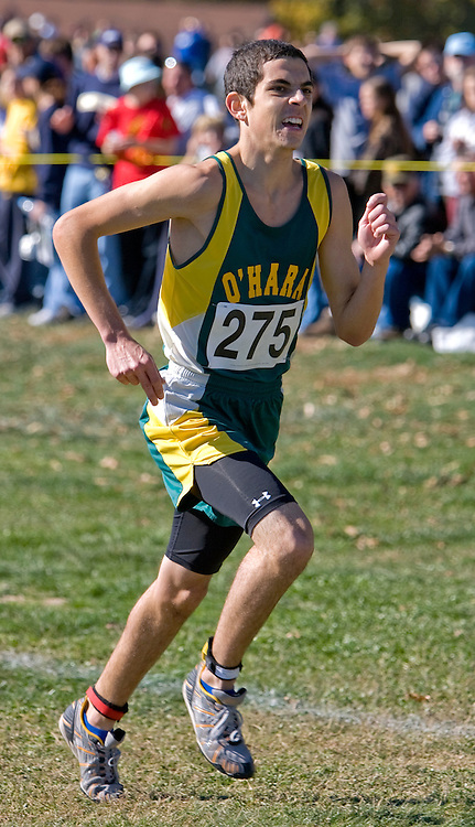 Junior Max Storms of O'hara high school races to the finish line at the 2007 MSHSAA cross country boys class two championships at the Oak Hills golf center in Jefferson City, MO on Saturday, November 3rd, 2007. Storms claimed a 1st place victory with a time of 16:39. Photo by Patrick Fallon