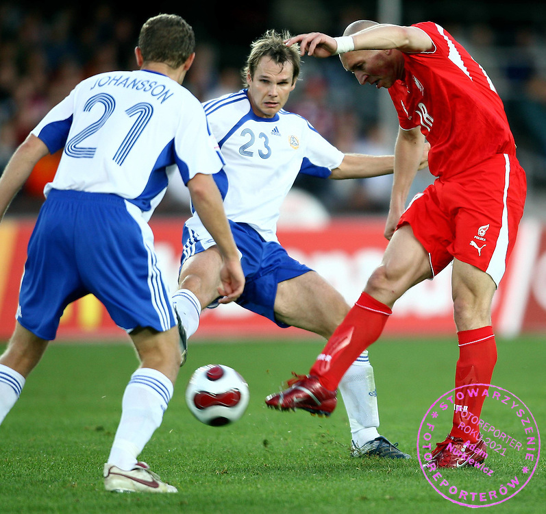 (C) MARKUS HEIKKINEN (FINLAND) & (R) MARIUSZ LEWANDOWSKI (POLAND)  DURING QUALIFING SOCCER MATCH EURO 2008 BETWEEN FINLAND AND POLAND..HELSINKI , FINLAND , SEPTEMBER 12, 2007.( PHOTO BY ADAM NURKIEWICZ / MEDIASPORT )