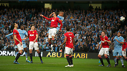 MANCHESTER, ENGLAND - Monday, April 30, 2012: Manchester City's Vincent Kompany scores the first goal against Manchester United during the Premiership match at the City of Manchester Stadium. (Pic by Chris Brunskill/Propaganda)