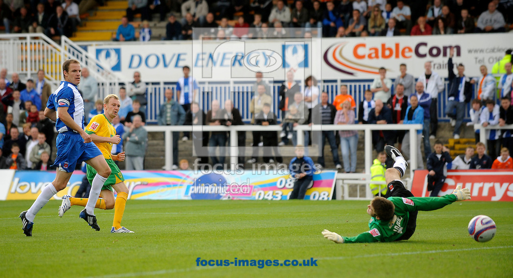 Hartlepool - Saturday August 29th, 2009: Stephen Hughes of Norwich City puts the ball past Hartlepool goalkeeper Scott Flinders to score their second goal during the Coca Cola League One match at Victoria Park, Hartlepool. (Pic by Jed Wee/Focus Images)..