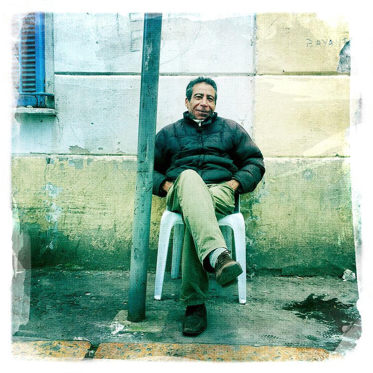 "Abdel khader is sitting every day at the corner of rue El koufa, he has no job nothing to do, february 7, 2011. /// Copyright Benjamin Girette. On january the 14th 2011, Zine el-Abidine Ben Ali President of Tunisia and his famous wife Leila Trabelsi as know as ""The regent of Carthage"" are forced to escape the country after 24 years of power..The revolution is not done yet, Ben Ali is gone nevertheless a democratic President still needs to emerge. A new democraty is in design for the next six months, it might be the birth of the first democraty in the arab world..."
