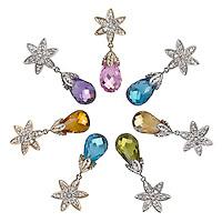 garnet teardrop earrings on a diamond setting, garnet teardrop earrings on a starshaped diamond setting