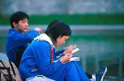 CHINA SHANGHAI NOV01 - Chinese schoolgirls solve their homework at nearby lake.. . jre/Photo by Jiri Rezac. . © Jiri Rezac 2001. . Contact: +44 (0) 7050 110 417. Mobile:  +44 (0) 7801 337 683. Office:  +44 (0) 20 8968 9635. . Email:   jiri@jirirezac.com. Web:     www.jirirezac.com