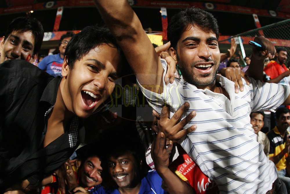 Spectators enjoying the atmosphere during match 10 of the the Indian Premier League ( IPL) 2012  between The Royal Challengers Bangalore and the Kolkata Knight Riders held at the M. Chinnaswamy Stadium, Bengaluru on the 10th April 2012..Photo by Jacques Rossouw/IPL/SPORTZPICS