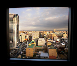 Japan.Sapporo. Buildings through the window.©Carmen Secanella.