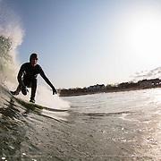 Surfing Monahan's Dock. Swell 12' at 11 secs. Kurtis Niles barrel set up.