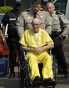 Edgar Ray Killen is surrounded by police officers as leaves the Neshoba Conty Court House after sentencing, thursday June 23,2005. The media nd locals surround the courthouse ramp anticipating Killens exit. Killen will serve 60yrs to run consecutively.he sentencing in his triple manslaughter case  heavily gurded and not handcuffed in his yellow Neshoba County prison jumpsuit,Thursday June 23,2005 in Philadelphia,Ms. Its the maxium sentence he could get.(Photo/Suzi Altman)