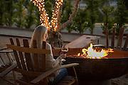 Woman wine tasting by fire pit, Allegretto Resort, Paso Robles, California