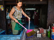16 OCTOBER 2015 - BANGKOK, THAILAND:  DAOLAOM SITTHIRUNG, 47, cleans up her small shop ahead of her eviction in the Wat Kalayanamit neighborhood. Fifty-four homes around Wat Kalayanamit, a historic Buddhist temple on the Chao Phraya River in the Thonburi section of Bangkok, are being razed and the residents evicted to make way for new development at the temple. The abbot of the temple said he was evicting the residents, who have lived on the temple grounds for generations, because their homes are unsafe and because he wants to improve the temple grounds. The evictions are a part of a Bangkok trend, especially along the Chao Phraya River and BTS light rail lines. Low income people are being evicted from their long time homes to make way for urban renewal.   PHOTO BY JACK KURTZ