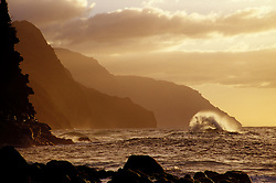 United States, Hawaii, Kauai, Waves and cliffs at sunset