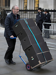 © Licensed to London News Pictures. 08/12/2016. London, UK. Documents arrive at the Supreme Court in Westminster, London for the last day of a hearing to appeal against a November 3 High Court ruling that Article 50 cannot be triggered without a vote in Parliament. Photo credit: Peter Macdiarmid/LNP