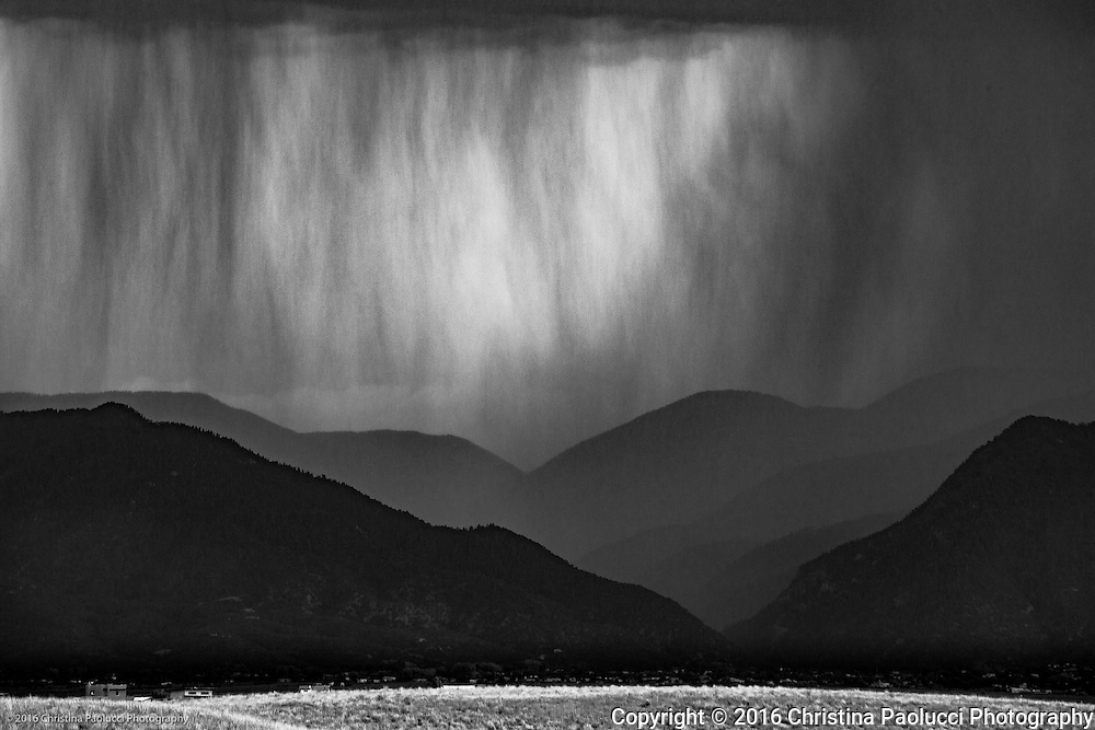 Between Rio Grande and Taos in June 2016 as a storm rolled in (Christina Paolucci, photographer).