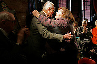 Rick Roberts (cq) (left) and Connie Broom (cq) hug  at The Spotted Dog--which used to house Fire Station 11--during a commemoration to mark the 60th anniversary of the Winecoff Hotel fire in downtown Atlanta. Roberts, a firefighter at the time who went on to become battalion chief, is credited with helping to save several of the survivors. Broom, 1 year old at the time, survived the blaze with her parents. The fire--at 119 deaths, the worst hotel fire in U.S. history--caused departments across the country to update their  safety codes.