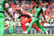 17th February 2019, Marvel Stadium, Melbourne, Australia; Australian Big Bash Cricket League Final, Melbourne Renegades versus Melbourne Stars; Dwayne Bravo of the Melbourne Stars attempts to run Tom Cooper of the Melbourne Renegades out by kicking the ball to the wicket