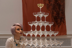 "© Licensed to London News Pictures. 26/01/2017. London, UK. A staff member views ""Monument to Katy Fisher, then Cleopatra and maybe a bit Marie Antoinette"" by Mark Corfield-Moore at ""Premiums Interim Projects"", an exhibition of new work by 13 second year students at the Royal Academy, Piccadilly, who are at the interim point of their postgraduate study at RA Schools, the UK's longest established art school. Photo credit : Stephen Chung/LNP"
