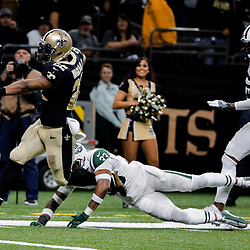 Dec 17, 2017; New Orleans, LA, USA; New Orleans Saints running back Mark Ingram (22) runs 50 yards for a touchdown past New York Jets strong safety Jamal Adams (33) during the fourth quarter at the Mercedes-Benz Superdome. The Saints defeated the Jets 31-19. Mandatory Credit: Derick E. Hingle-USA TODAY Sports