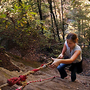 ASHEVILLE, NC - OCTOBER 30: A hiker lmakes her way up a rock face in Pisgah National Forest, in the Appalachian Mountains outside Asheville in North Carolina.(Photo by Logan Mock-Bunting) Sarah VDP hikes through Pisgah National Forest near Asheville, North Carolina.