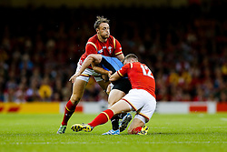 Wales Outside Centre Cory Allen and Inside Centre Scott Williams make a tackle - Mandatory byline: Rogan Thomson/JMP - 07966 386802 - 20/09/2015 - RUGBY UNION - Millennium Stadium - Cardiff, Wales - Wales v Uruguay - Rugby World Cup 2015 Pool A.