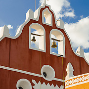 The front of the main steeple with bells of the Candelaria Church in Valladolid, a colonial town in Yucatan, Mexico.
