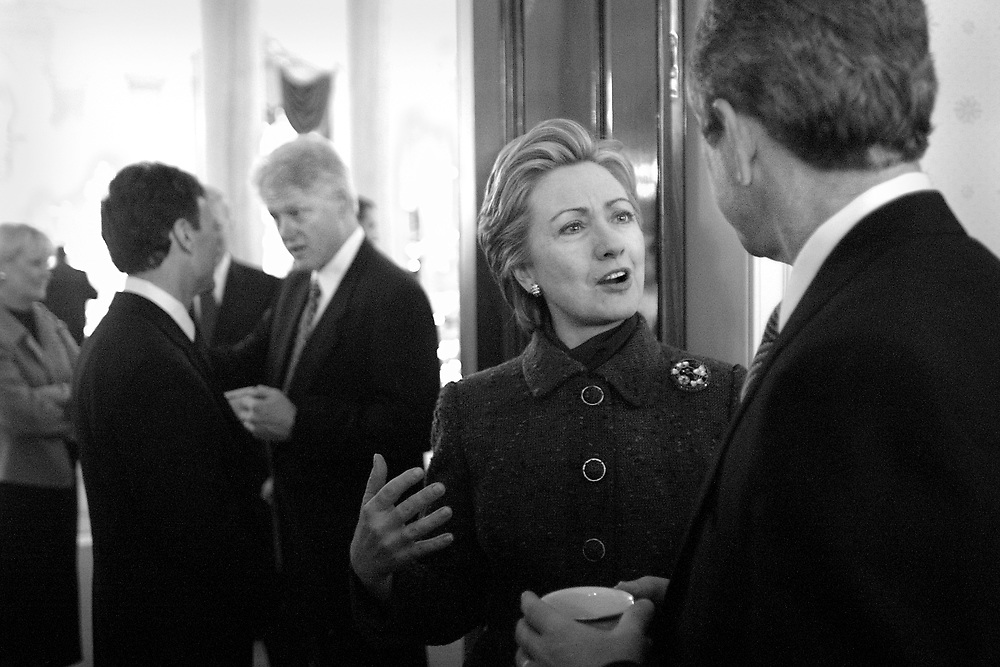 During the pre-inaugural coffee at the White House, Hillary speaks to George W. Bush has President Clinton talks with Sen. Tom Daschle.