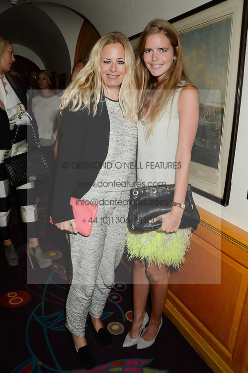 Left to right, ASTRID HARBORD and KATIE READMAN at an exhibition of the 50 best party pictures from Tatler from the past 50 years, held at Annabel's, Berkeley Square, London on 9th September 2013.