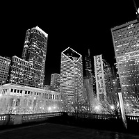 Chicago downtown at night from Millennium Park with buildings along Michigan Avenue including the Smufit Stone Building, Prudential Buildings, Trump Tower, and the Chicago Cultural Center (Chicago Pvblic Library).