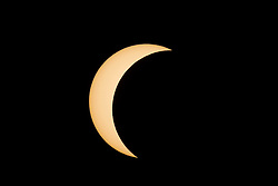 © Licensed to London News Pictures. 09/03/2016 Ipoh, Malaysia. A partial solar eclipse near its maximum is seen over the city of Ipoh in Malaysia, Wednesday, March 9, 2016. Photo credit : Sang Tan/LNP
