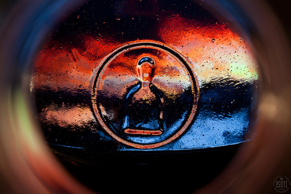 """Beauty at the Bottom: Tequila Sunrise 9"" - This is a photograph of a tequila bottle, shot right down inside the mouth of the bottle."