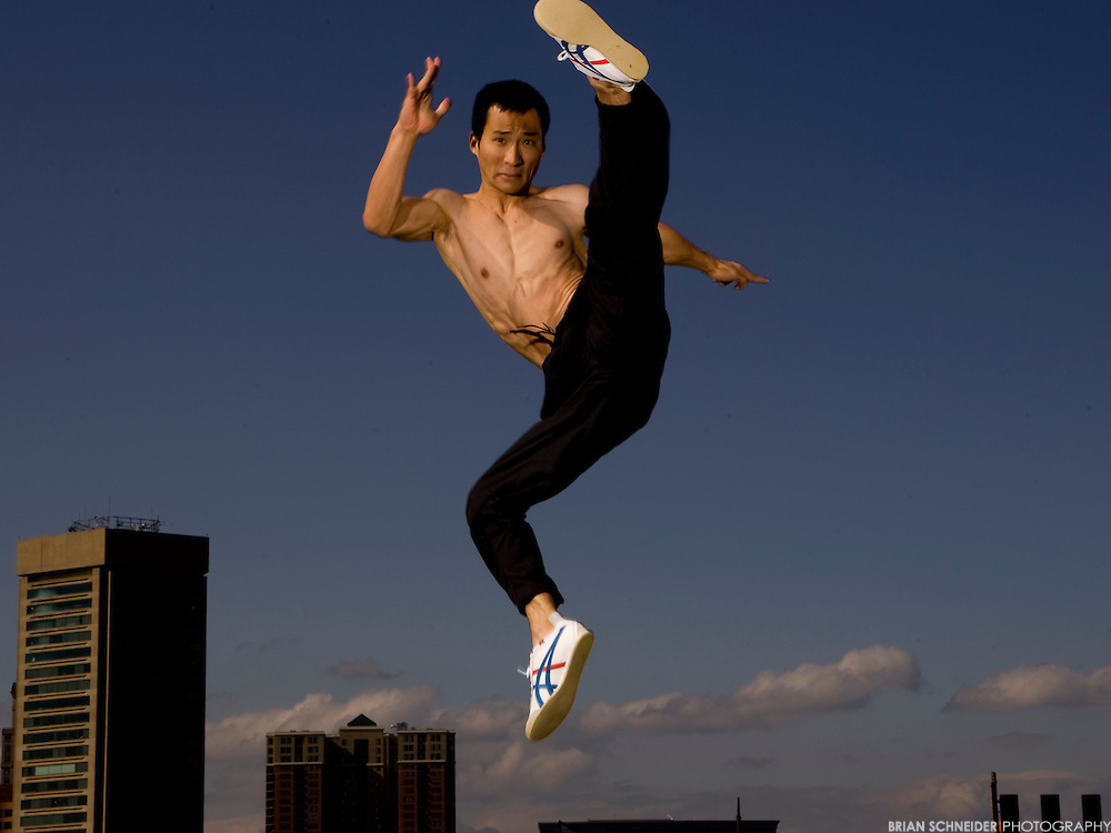 Apr 17, 2010; Baltimore, MD, USA; Model Wonsup Chung performs acrobatic movements and kicks at historic Federal Hill Park, which overlooks the Inner Harbor in Baltimore, MD. Mandatory Credit: Brian Schneider-www.ebrianschneider.com