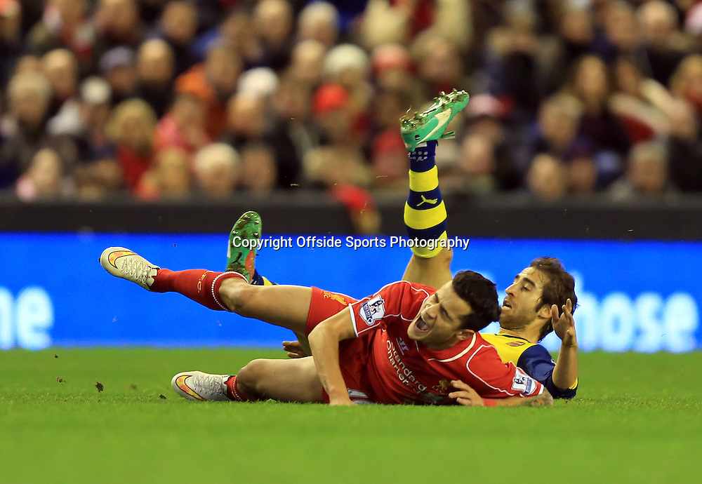 21 December 2014 - Barclays Premier League - Liverpool v Arsenal - Mathieu Flamini of Arsenal is shown a yellow card of this tackle on Philippe Coutinho of Liverpool - Photo: Marc Atkins / Offside.